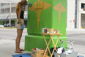 Robin Daning painting utility box on Tulane Avenue