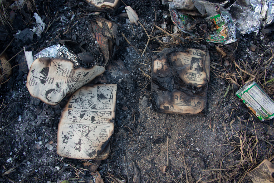 burned comic books at Chinese Cemetery in Samut Sakhon Province