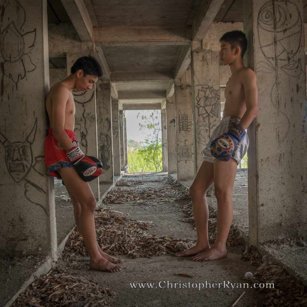 shirtless boys muay thai boxing