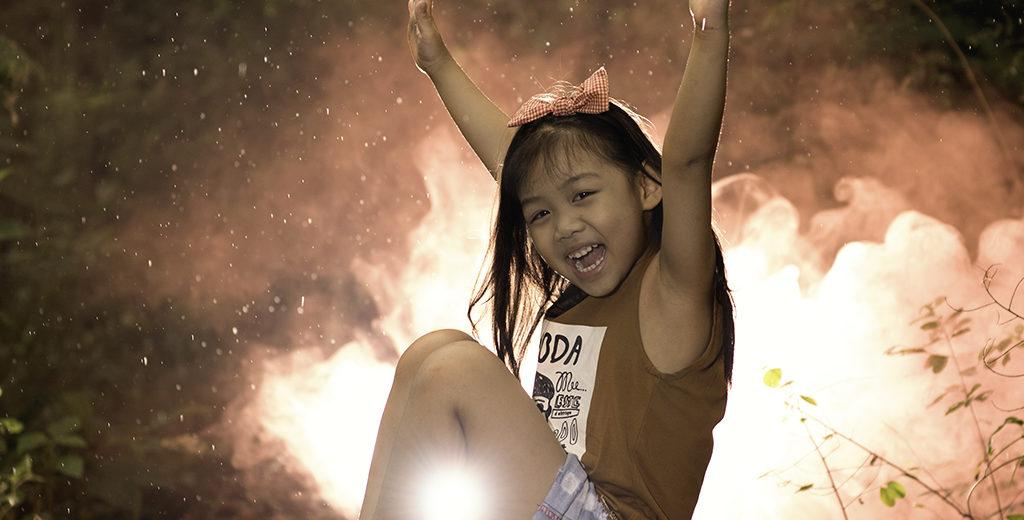 colored smoke photography little girl