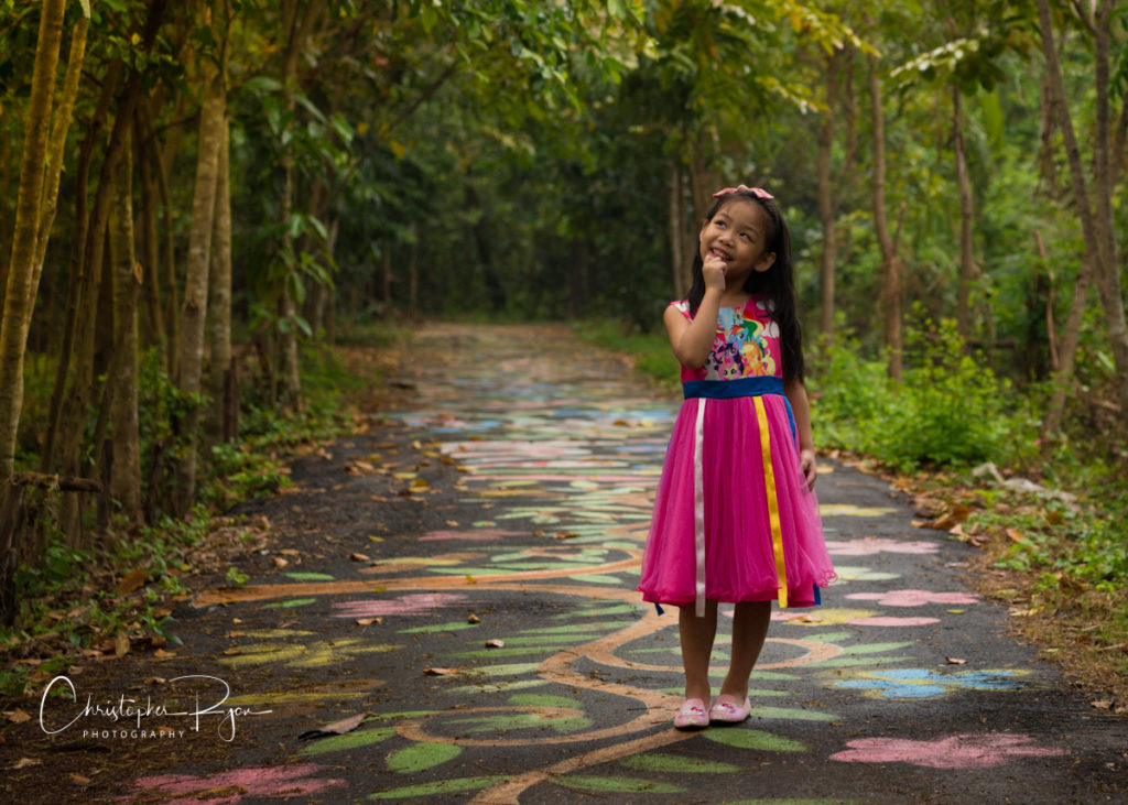 little girl princess in fairytale land wearing pink shoes