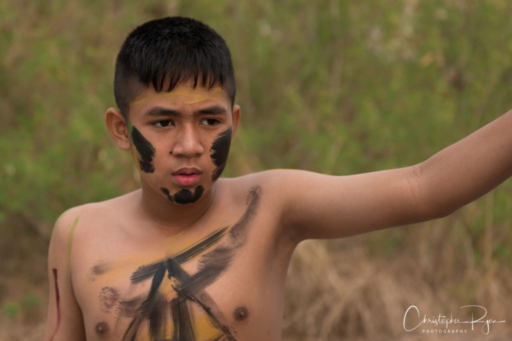 shirtless boy with tribal bodypaint