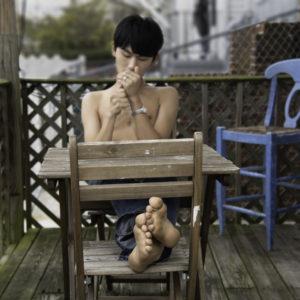 barefoot male smoking