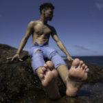 hot barefoot teen boy in Aruba showing his beautiful soles