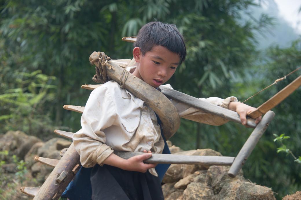 Village boy working