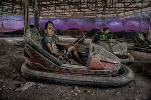 boy in abandoned amusement park