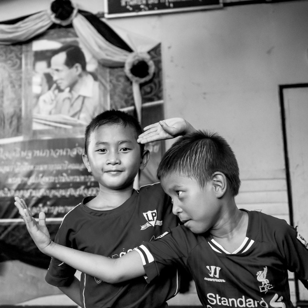 young boys playing in bangkok.