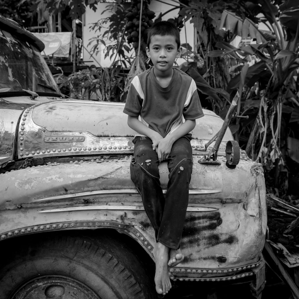 barefoot boy on an old truck