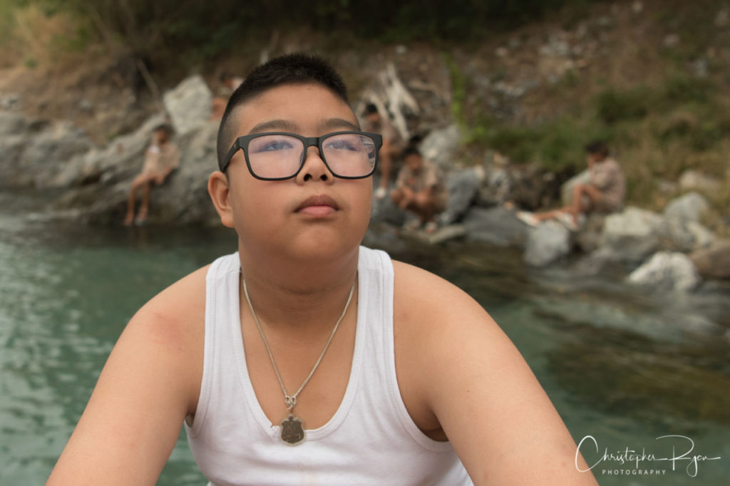 overweight nerdy boy in wifebeater shirt