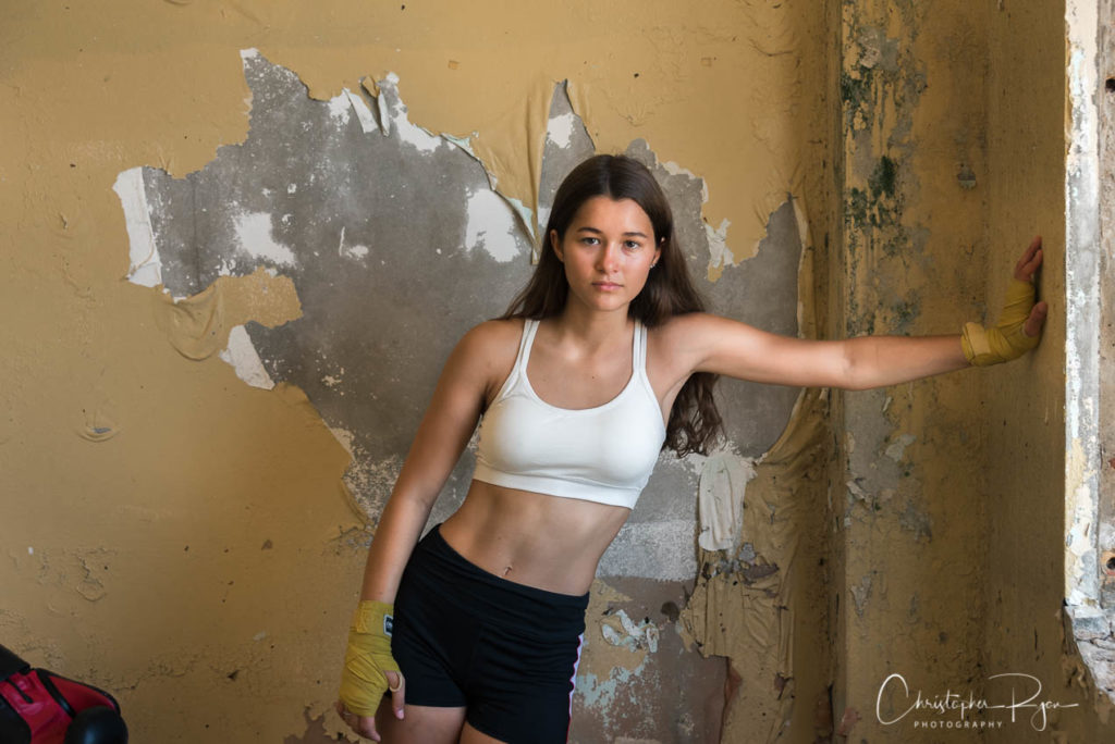 teen girl with nice abs in abandoned school