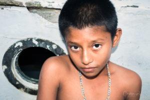 beautiful young shirtless latino boy with big eyes