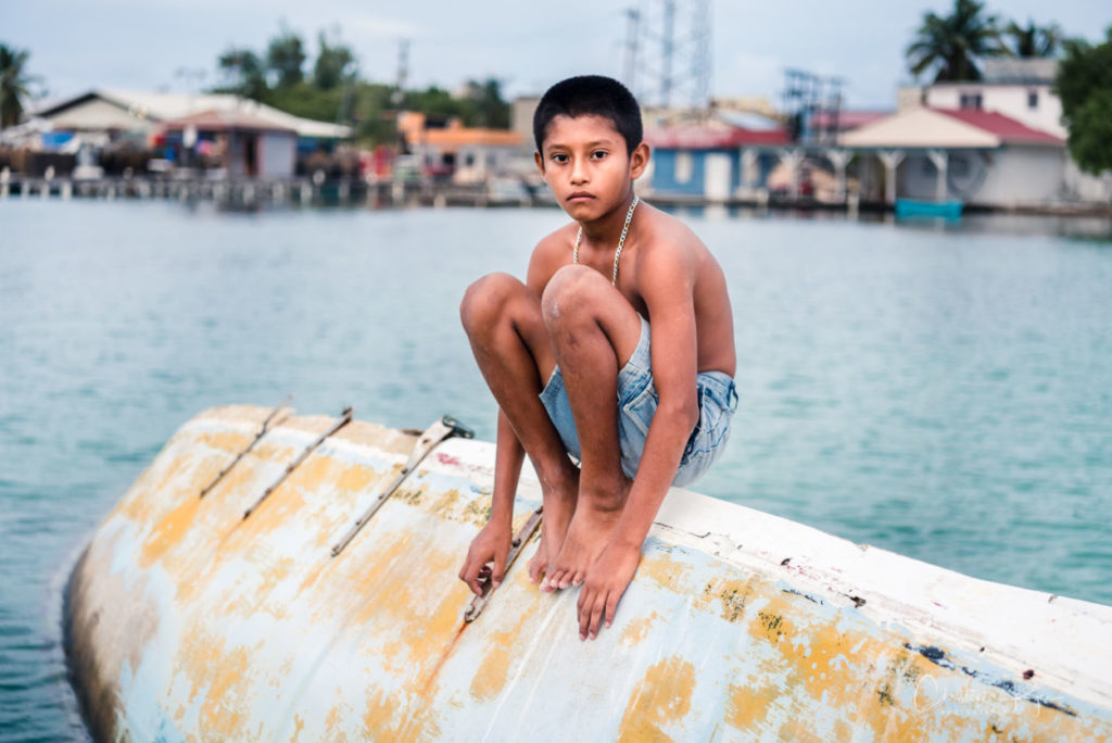 boy posing on abandoned boats for the youth and urban decay photography project