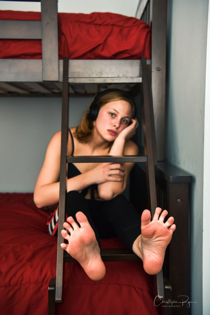 girl relaxing and showing the soles of her beautiful seductive feet.