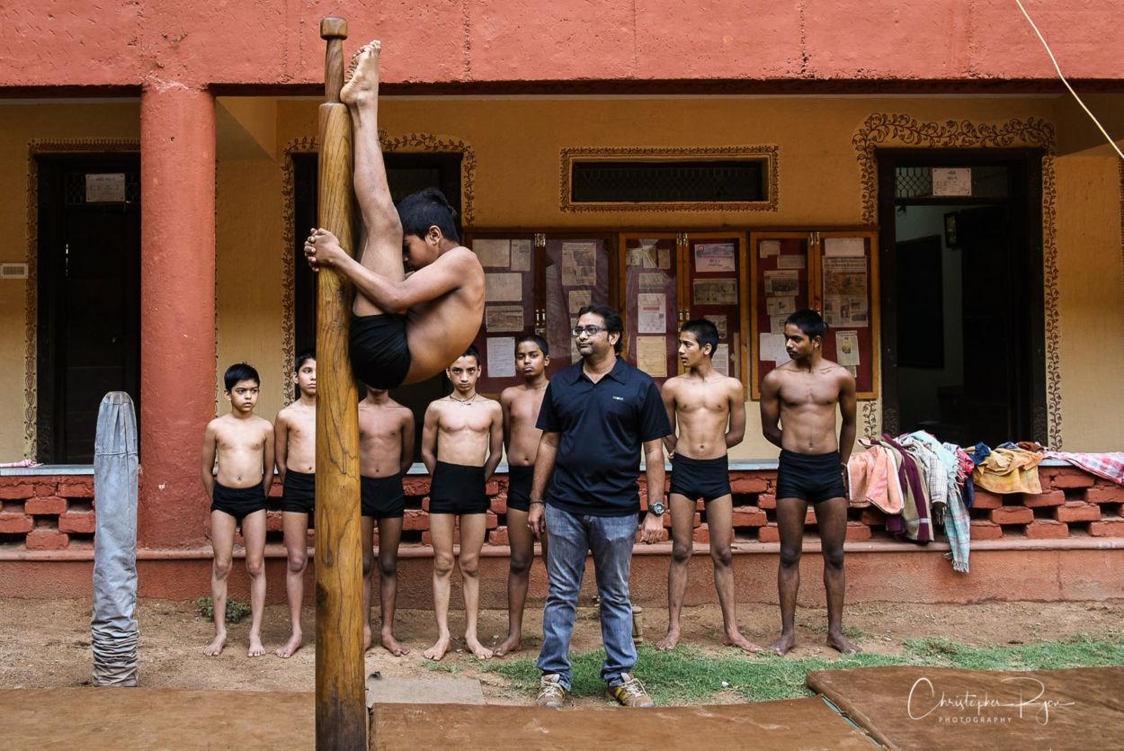 aerial arts coach jayesh Cacha teaching mallakhamb