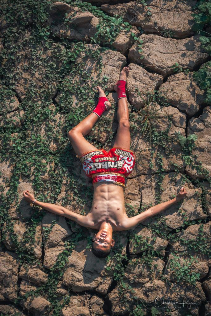 shirtless teen muay thai fighter