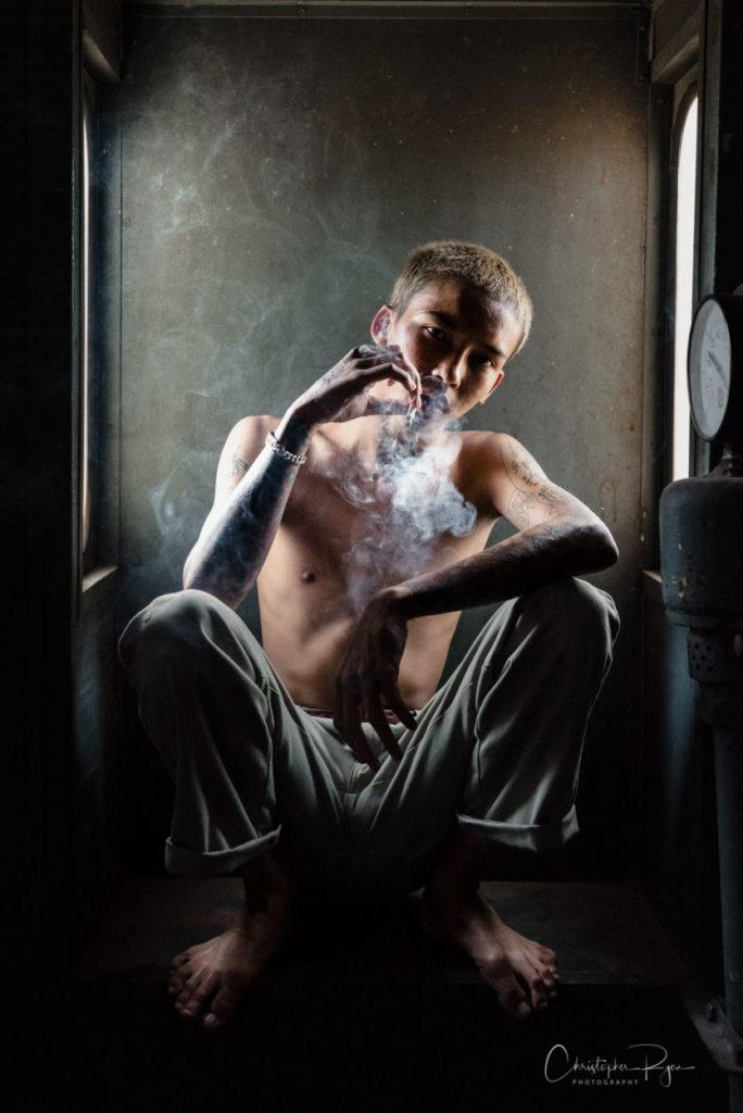 hot shirtless boy smoking a cigarette