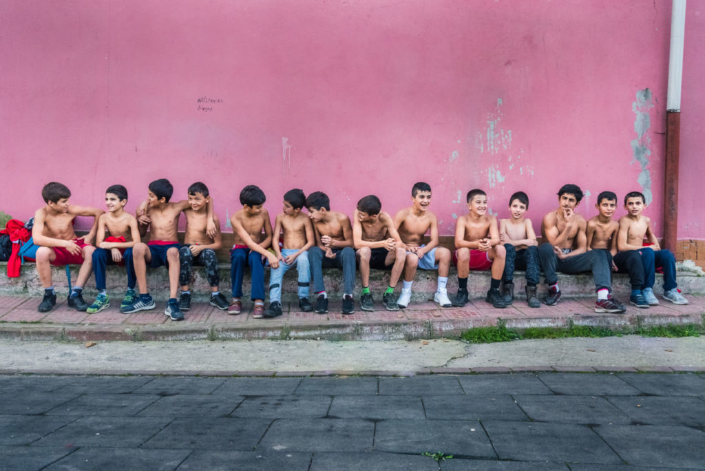 a group of boys outside of a turkish oil wrestling gym
