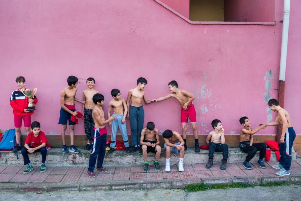 child and teen boys shirtless outside a gym in Istanbul, Turkey