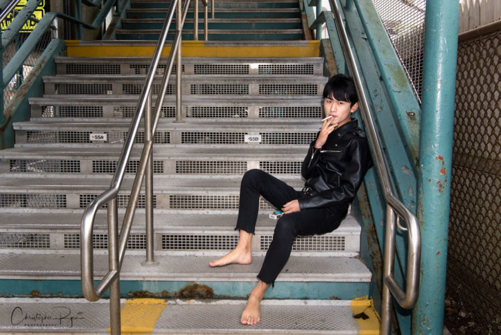 barefoot and sexy teen boy sitting on stairs at NYC subway entrance