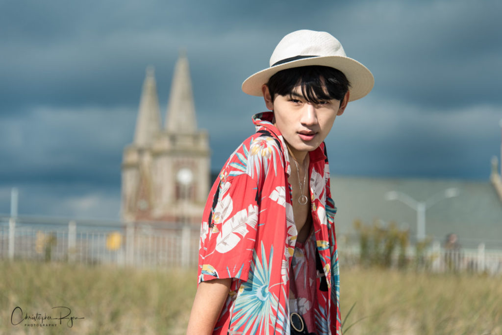 sexy asian teen boy with open Hawaiian shirt