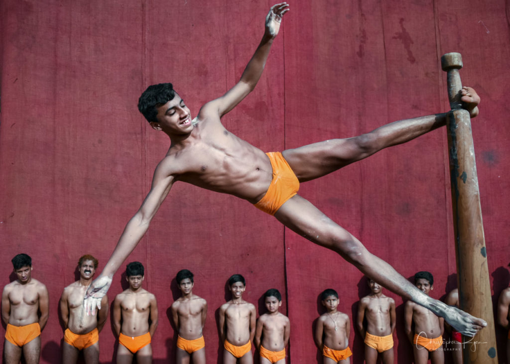 Sagar Rane, age 18 performing Payacha Fara on Pole Mallakhamb