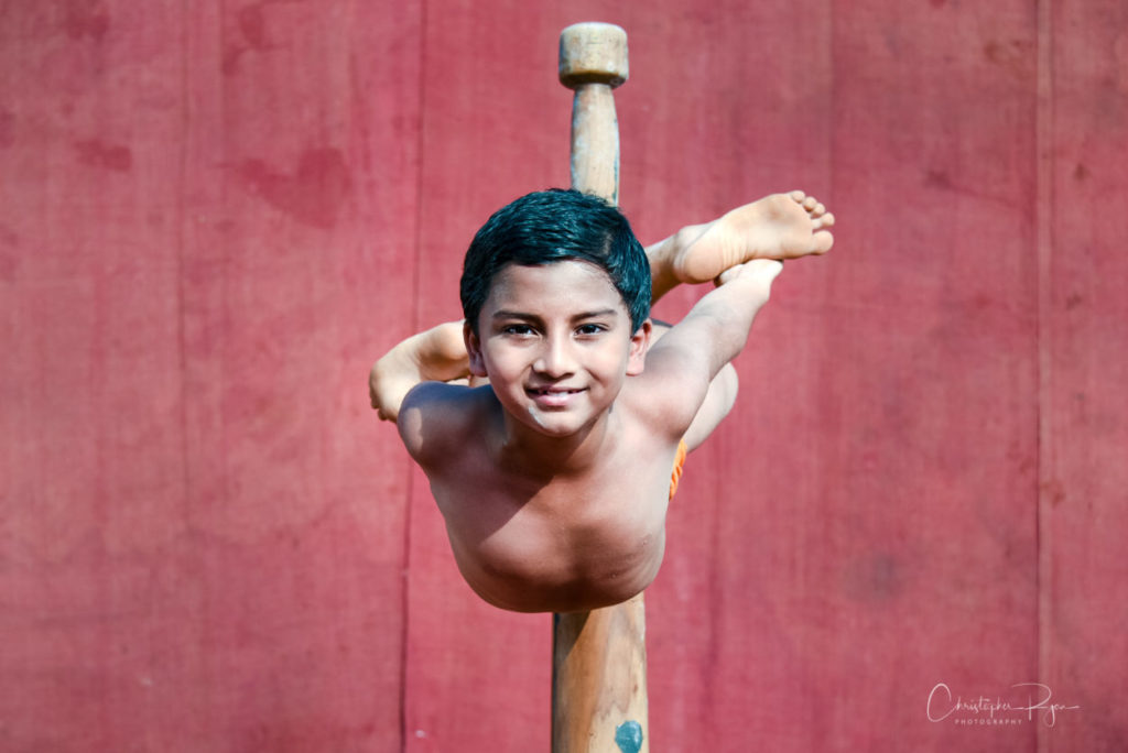 Somansh Dalvi, age 10 performing Matsyasan on Pole Mallakhamb