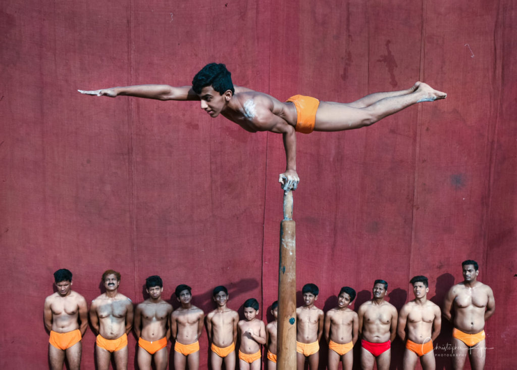 One Hand Mayurasan on Pole Mallakhamb at Shree Samartha Vyayam Mandir in Mumbai, India