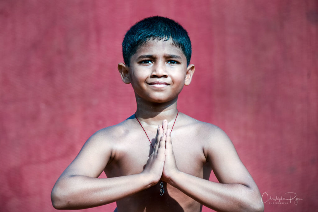 Atharav Kale, 10 year old shirtless boy Peforming Sitting postion on Pole Mallakhamb at Shree Samartha Vyayam Mandir in Mumbai, India