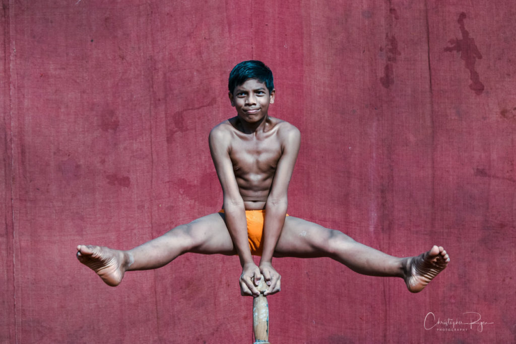 14 year old shirtless pole mallakhamb performer in mumbai, india