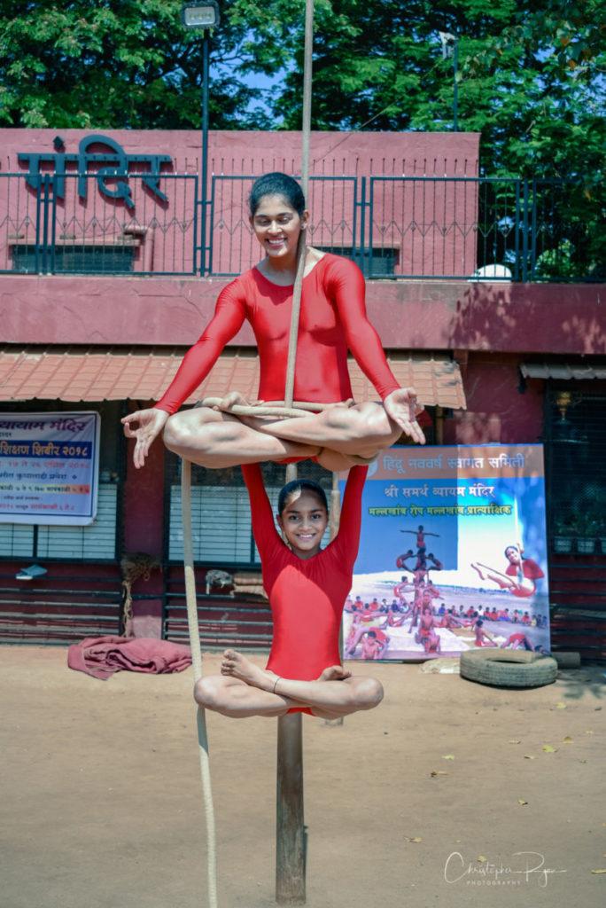 Aditi Karambelkar, age 18 & Grishma Desai 9 performing pyramid of Padmasan & Hanging Padmasan on Rope Mallakhamb