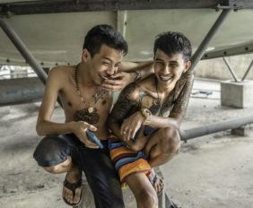 shirtless boys giggling